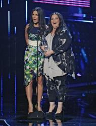 "Sandra Bullock and Melissa McCarthy accept the award for favorite comedic movie for ""The Heat"" at the 40th annual People's Choice Awards at the Nokia Theatre LA Live on Jan. 8, 2014, in Los Angeles."