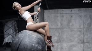Miley Cyrus is shown in her Wrecking Ball video.