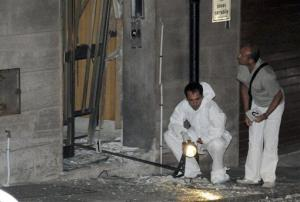 Police check the area where a bomb went off in southern Italy in this 2010 file photo. It damaged the home of a judge who investigates the 'Ndrangheta crime syndicate.