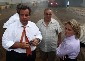 In this Sept. 12, 2013, then Christie aide Bridget Anne Kelly stands with Gov. Chris Christie during a tour of the Seaside Heights, N.J., boardwalk after a fire.