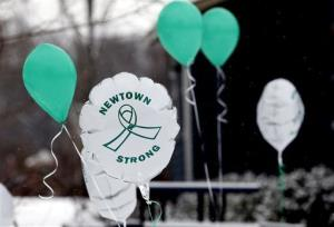 Balloons fly outside a doctor's office on the first anniversary of the Sandy Hook massacre, in Newtown, Conn., on Dec. 14, 2013.
