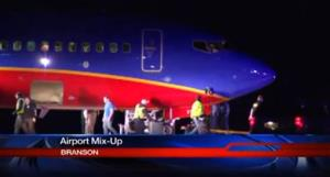 This frame grab provided by KSPR-TV shows a Southwest Airlines flight that was scheduled to arrive Sunday, Jan. 12, 2014, at Branson Airport in southwest Missouri.