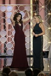 This image released by NBC shows hosts Tina Fey, left, and Amy Poehler during the 71st annual Golden Globe Awards at the Beverly Hilton Hotel on Sunday, Jan. 12, 2014, in Beverly Hills, Calif.