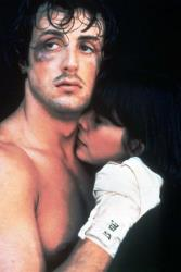 In this 1976 file photo originally released by United Artists, Sylvester Stallone, left, and Talia Shire are shown in a scene from the Rocky.