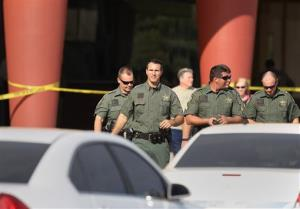 Pasco Sheriff Chris Nocco, front, walks out to update reporters after an argument between patrons over texting sparked a shooting that left one person dead and another injured in a Pasco County movie theater Monday Jan. 13.