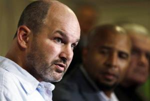 In this April 9, 2013, file photo, former NFL player Kevin Turner, who suffers from Lou Gehrig's disease, speaks.