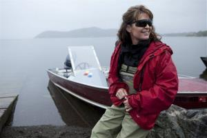 Sarah Palin waits by her husband Todd's boat before heading up river to see fish being counted in Dillingham, Alaska as part of her Sarah Palin's Alaska series.