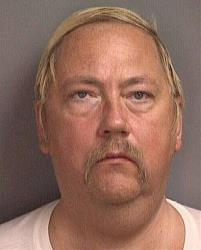 A 1998 booking photo, provided by the Salt Lake County Jail, shows Thomas Ray Lippert.