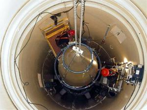 In this image released by the U.S. Air Force, a Malmstrom Air Force Base missile-maintenance team removes the upper section of an ICBM.