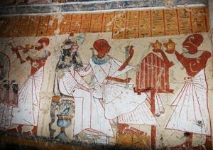 This image released by the Supreme Council of Antiquities shows colored inscriptions on a newly discovered tomb in Egypt.