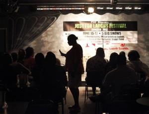 In this June 8, 2012 photo, the owner of the Jokes and Notes comedy club is silhouetted.