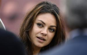 Mila Kunis walks along the sideline before the NFL football game between the Pittsburgh Steelers and the Chicago Bears at Heinz Field on Sunday, Sept. 22, 2013, in Pittsburgh.