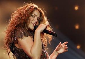 Shakira performs during the German opening concert of her Oral Fixation Tour in Hamburg, in 2007.