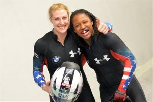 Jamie Greubel, left, and Lauryn Williams of the United States pose for media after winning the two-women Bob World Cup race in Innsbruck, Austria on the weekend.