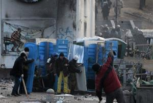 Protesters erected barricades in Kiev after a night of rioting and street protests.