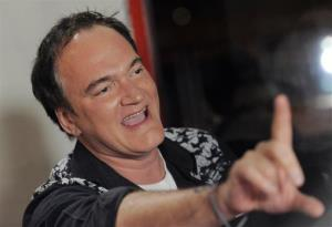 Director Quentin Tarantino gestures to photographers at the 2013 AFI Fest premiere of the film Nebraska at the TCL Chinese Theatre on Monday, Nov. 11, 2013 in Los Angeles.