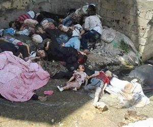 In this May 4, 2013 file photo shows dead bodies in Banias, Syria.