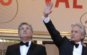 Actor Michael Douglas, right, and Scott Thorson stand at the top of the stairs as they arrive for the screening of Behind the Candelabra at the 66th international film festival, in Cannes, southern France, Tuesday, May 21, 2013.