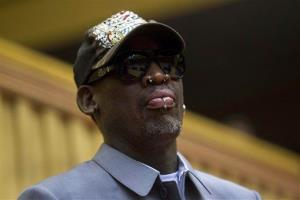 Dennis Rodman, looks out at the court at the end of an exhibition basketball game in Pyongyang, North Korea on Wednesday, Jan. 8, 2014.