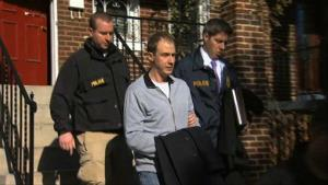 This Dec. 11, 2013, image provided by WJLA-TV shows Ryan Loskarn, former chief of staff to Sen. Lamar Alexander, R-Tenn., being escorted from his Washington home by police.