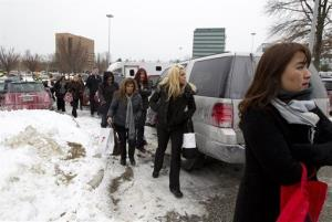 People are evacuated from the Mall in Columbia, Md.