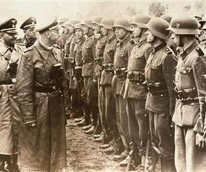 The June 3, 1944 photo shows Heinrich Himmler, center, as he reviews troops of the Galician SS-Volunteer Infantry Division
