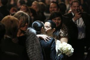 Audience members participate in a same sex wedding during a performance of Same Love by Macklemore and Ryan Lewis at the 56th annual Grammy Awards at Staples Center on Sunday, Jan. 26, 2014, in Los Angeles.