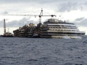The Costa Concordia cruise liner lies in the waters of the Giglio Island, Italy, Thursday, Jan. 23, 2014.