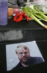 A makeshift memorial is seen, Monday, Feb. 3, 2014, outside the building where the body of actor Philip Seymour Hoffman was found in New York.