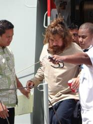 In this Feb. 3, 2014 photo, a man who identifies himself as Jose Salvador Alvarenga, center, gets off a ship in Majuro, the Marshall Islands.