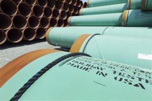 In this May 24, 2012 file photo, some of about 500 miles worth of coated steel pipe, originally for the Keystone oil pipeline, is stored in Little Rock, Ark.