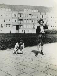 In this May 1941 photo provided by the Anne Frank House Museum, Anne Frank, left, plays with her friend Hanneli Goslar, right, on the Merwedeplein square in Amsterdam.