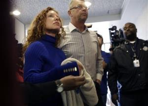 Tonya Couch, left, and Fred Couch, parents of teenager Ethan Couch, arrive at juvenile court in Fort Worth, Texas yesterday.