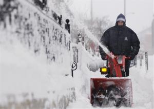David Sarja clears the sidewalk in front of the Lutheran Healthdcare Center in Worcester, Mass on Wednesday Feb. 5, 2014.