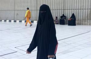 In this Monday, Dec. 9, 2013 file photo, a veiled woman walks in Mecca, Saudi Arabia.