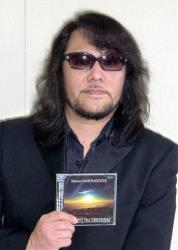 In this 2011 photo, Mamoru Samuragochi poses with his CD Symphony No.1 Hiroshima in Japan.