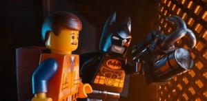 This image released by Warner Bros. Pictures shows characters Emmet, voiced by Chris Pratt, left, and Batman, voiced by Will Arnett, in a scene from The Lego Movie.