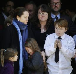 Mimi O'Donnell, center, estranged partner of Philip Seymour Hoffman, stands with their three children, from left, Willa, Tallulah and Cooper, in the doorway of the Church of St. Ignatius Loyola.