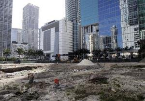 People work at a site in downtown Miami inhabited long ago by the Tequesta Indians.