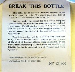 This photo released by the Woods Hole Oceanographic Institution shows a message found inside a glass bottle recovered on Sable Island, Nova Scotia.