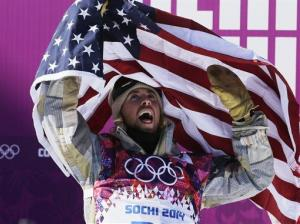 United States' Sage Kotsenburg celebrates after winning the men's snowboard slopestyle competition.