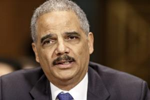 In this Jan. 29, 2014 file photo, Attorney General Eric Holder testifies on Capitol Hill in Washington.
