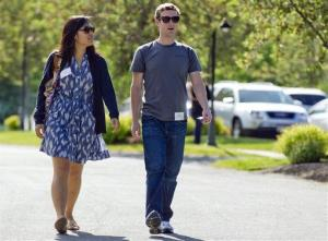 Mark Zuckerberg, president and CEO of Facebook, walks with Priscilla Chan during the Sun Valley Conference, in Sun Valley, Idaho.