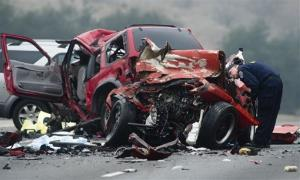 Officials investigate the scene of a multiple vehicle accident where 6 people were killed on the westbound Pomona Freeway in Diamond Bar, Calif. on Sunday morning, Feb. 9, 2013.