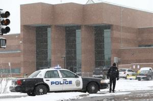 A police cruiser blocks the entrance to Standley Lake HIgh School, where classes were cancelled after an apparent suicide attempt by a student, in Westminster, Colo., Monday, Jan. 27, 2014.
