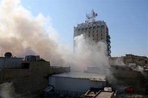 In this Wednesday, Feb. 5, 2014 file photo, smoke rises after a parked car bomb went off in central Baghdad, Iraq.