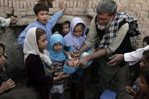An Afghan child is vaccinated against polio during a polio eradication campaign in Jalalabad, east of Kabul, Afghanistan.