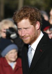 Britain's Prince Harry arrives to attend a Christmas Day Service at St. Mary's church on the grounds of Sandringham Estate, the Queen's royal estate in Norfolk, England, Wednesday, Dec. 25, 2013.