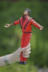 In this file photo, a fan holds a Michael Jackson doll on the anniversary of his death.