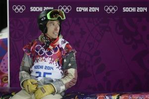 Shaun White looks at the scoreboard after competing in the men's snowboard halfpipe final at the Rosa Khutor Extreme Park, at the 2014 Winter Olympics, Feb. 11, 2014, in Krasnaya Polyana, Russia.